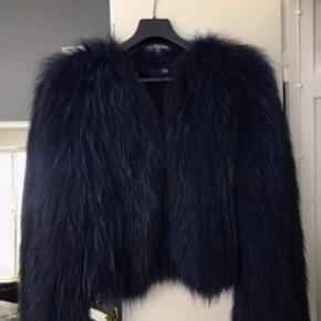 Ægte vaskebjørn pels