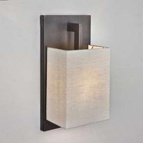 The Coconette Wall Light is like a chameleon, able to fit into any space whether it is casual or elegant. With its clean simple lines and variety of shade options Coconette is sure to feel right at home in your hallway, living room, or dining room. Comes with a satin bronze backplate and choice of shade in either coto white or white linen.