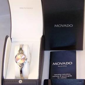 MOVADO stainless steel lady's watch in pink with 6 diamonds.