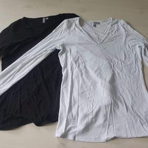 Sort og hvid bluser fra ASOS. Brugt kortvarigt i graviditeten. Vasket i Neural og sælges samlet.