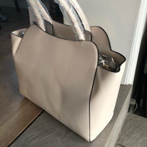 Helt ny og fin taske i baby lyserød