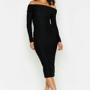 Den ultimative stam-ind bodyshape kjole. Meget elastisk i kraftig kvalitet