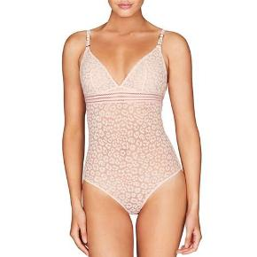 Stella McCartney bodysuit in peach Leo print. Fit true to size. Brand new. Available in size small and medium. Check my other listings of Stella as well.