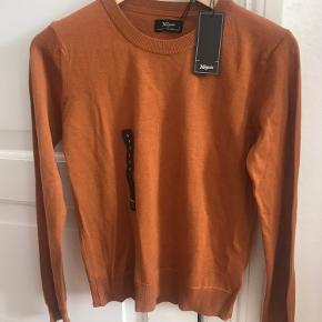 Lækker merino uld sweater fra Magasin. Aldrig brugt.
