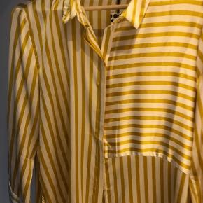 Aldrig brugt stribet skjorte.  Så smuk, men for lille. Oprindelig pris 250 kr.