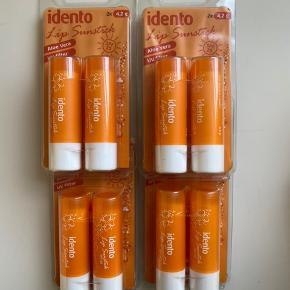 Idento læbepomade med sunprotection.  8 stk sælges samlet. Aldrig brugt.  Porto kommer oveni. Ingen bytte.  #30dayssellout