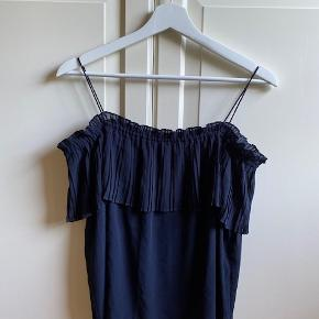 Cute top by Massimo Dutti - made of double layered material. It has short cutted sleeves.  The label size is S, but it's a bit loose so can fir M as well.  I can send more photos, and I am sending the blouse by DAO or we can meet