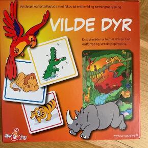 Vendespil med en plakat hvor dyrerne er på. Fra sprog&leg.