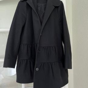 COS frakke