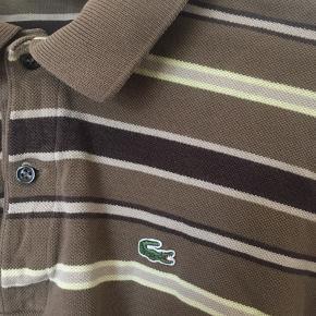 Stribet, vintage Lacoste trøje i str. S Købt i  genbrug I perfekt stand og kun personligt brugt et par gange