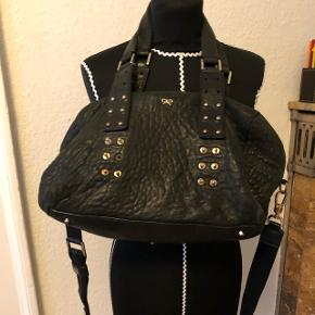 Black buttered genuine leather.