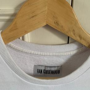 Plain white HAN Kjobenhavn t-shirt made from thick material. Bought from HAN's New York store some years ago.  Size S. Only worn a few times. 100% cotton.  Open to serious offers.