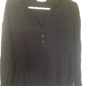 Black flowy blouse by Lush. It's longer in the back.  It's casual and lovely.  It's in really good condition