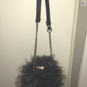 Ny fake fur taske, fra Tyrkiet aldrig brugt.
