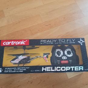 Fjernstyret helikopter perfekt gave   Helt nyåbnet fjernstyret helikopter   mærke cartronic   Sælges for 150 kr   afhentning på adressen i Hvidovre