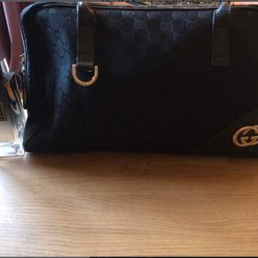 Gucci Bag. Great design, good condition but used. Really good size, can be used for day to day or if you are going away for the weekend as it can take a few bits in it.  Edit*** Dimensions are approx 35x25x7 It's made from the Gucci fabric so it's stretched a lot when you want to pack it full :)