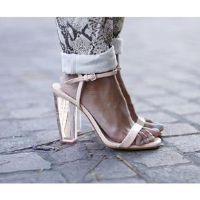 """Limited edition """"glass heel"""" shoes. Worn only once, a few small marks on the sole but they will be covered by your foot when worn. Very good condition. Stable and comfortable heel. Nude color visually extends the leg. #30dayssellout"""