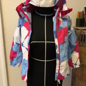 Softshell waterproof jacket for a girl, size 128. Never used