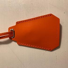 Nøglering i orange læder