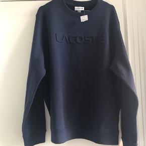 Den passer en L eller lille XL