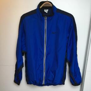 Vintage blå Nike overdel. Tip top stand fejler intet.