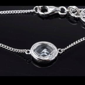 Fint Sterling sølvarmbånd fra C.L med hvid topaz.  Justerbar længde på: 16, 18, 20cm  Nyt og ubrugt