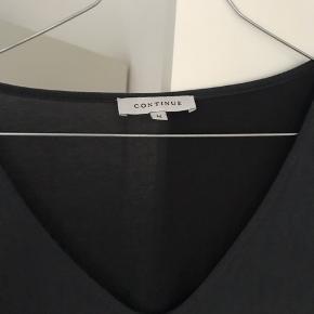 Continue kjole str m. Løs med flæser forneden :-)