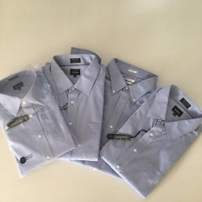 4 helt nye skjorter, 3 i mærket Neiman Marcus, den sidste i mærket VanHeusen. Pr stk 200kr alle 4 for 550kr. Størrelsen er 43/44. Køber betaler porto.