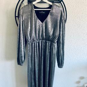 Silver medium length dress with elastic on the waist and big flying sleeves.  Almost new.