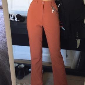 Orange flare / trompet bukser. Helt ubrugte :)