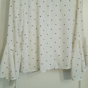 Polka dot white blouse with ruffled cuffs