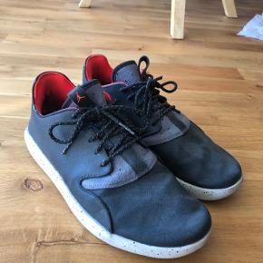 Limited edition! Model: Air Jordan Eclipse Holiday (2015) Colorway: Black/Cement  Signs of being worn, both shoes have a little hole on the heel side from putting on/off. Otherwise, they just need to be cleaned and look perfect. :)