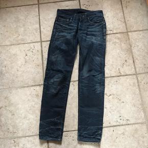 Blå cowboybukser low waist str. 27/32.