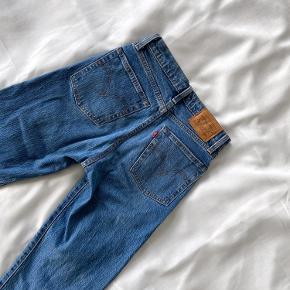 Barely worn Levi's Wedgie jeans (same fit as 501's, but tighter on the hips). Size 24 - would fit a standard size 34. Length- 89 cm, Waist - 32 cm laid flat.  No faults or signs of wear.