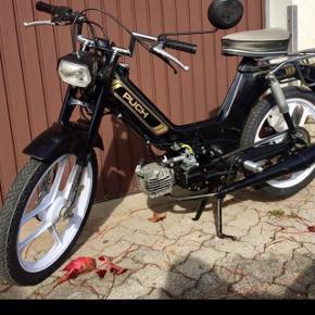 A vendre vélomoteur KTM - style Puch pièces d'origine  selle neuve  carte grise  de  couleur noir, jantes blanches  Très bon état