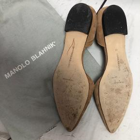 Camel-coloredManolo Blahnik d'Orsay suede flats with pointed toes and stacked heels. Includes dust bag.  Typically runs narrow and a half size smaller than anticipated.