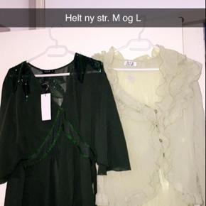 Den grønne er tunikaer helt nye med prismærke 😊 Str. M .  Den anden er bluse , aldrig brugt ..  Str. L ..  Gerne byd ..