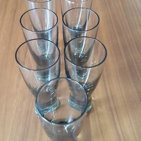 Syv portvinsglas fra Holmegaard. Canada smoke. 11,5 cm høje. Sælges samlet. Pris 325,-