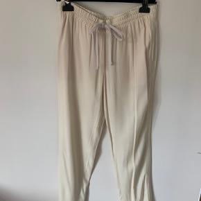 Céline by Pheobe Philo sily tracksuit pants  Gorgeous vanilla beige color and inside peach trim; silky fabric   Fits S/M best due to elastic waist  Has been worn a few times and now dry cleaned so comes to your home like new (preloved condition)