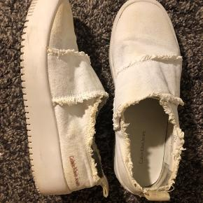 Really comfortable slip ons. They're white so they have some light yellow spots on them as I've worn them for a while but they're in still good condition otherwise.