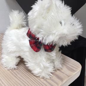 Den sødeste tøj hund med lyd den siger selv en smule uden batterier. Som ny. Ts betales af køber