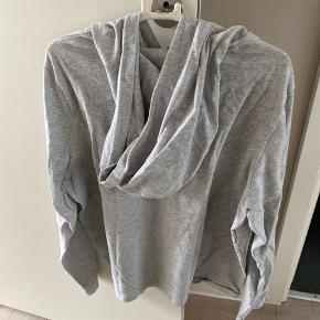Sweater fra Tommy Hilfiger Denim i XL. Langærmet og med hætte