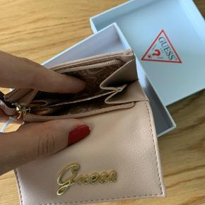 New wallet with price tag.   Pung Guess