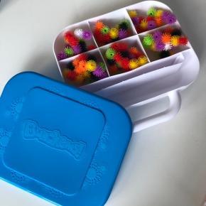 Bunchems - kreativt legetøj. Kan sættes fast fast på indersiden af låget.