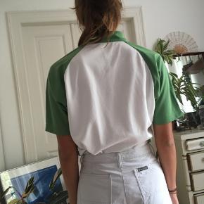 Meget fed sports bluse med lynlås