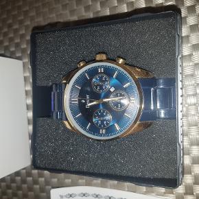 Dexter armbåndsur - mørkblå flot farve. Brugt 1-2 gange. Kvittering og garantibevis haves. Købt for ca. 1 år siden