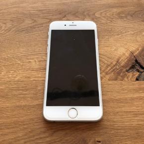 Apple iPhone 6 📱 - God stand - Hvid/Sølv - Kan afhentes i København S - 128 GB  - Køber kan vælge også at få 2 gratis covers med i købet (Bla. et fra Malene Birger)