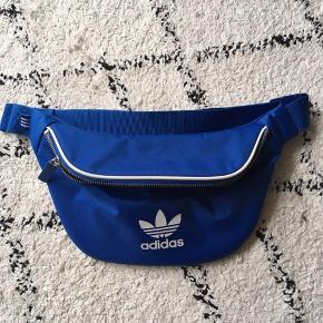 Sælger denne seje justerbare bæltetaske, som jeg ikke får brugt. Den er helt som ny.