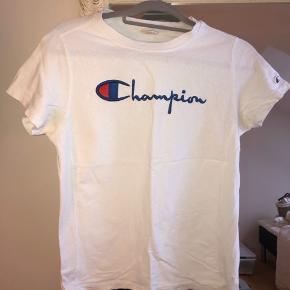Næsten ny champion tee.