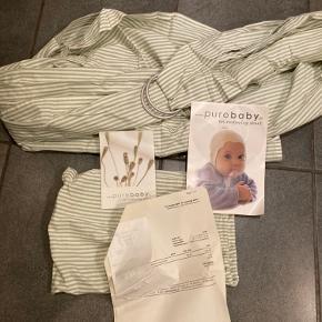 Babyslynge fra Purebaby. Aldrig brugt, kun prøvet. Kvittering og manual medfølger